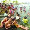 A SWIM TO HONOR A SAINT.  Families spend the day at the beach (or in this case, the waterfront less than three blocks from Cebu City Hall) to celebrate the Nativity of St. John the Baptist and to escape the late summer heat. (Sun.Star Cebu/Arni Aclao)