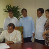 BACOLOD. Representative Alejandro Mirasol (5th district) signs his name in the roster of the House of Representatives. With him are his wife Mary Ann, Representatives Thirdy Maranon, Cesar Sarmiento and Albee Benitez. (Carla N. Cañet)