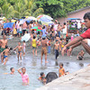 FEAST OF ST. JOHN. A man watches over the children who enjoy swimming at a beach near the Sta. Ana wharf where Catholic believers dip to celebrate the Feast of St. John the Baptist yesterday. (Seth delos Reyes)