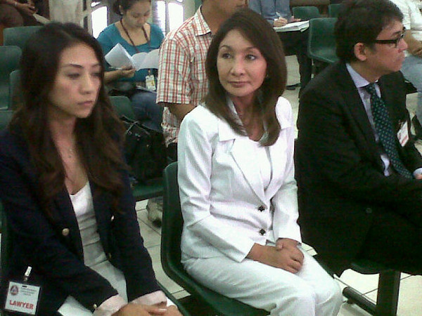 MANILA. Suspended Cebu Governor Gwendolyn Garcia (center) is flanked by lawyers Christina Frasco and Tranquil Salvador III during the rescheduled arraignment of her graft and malversation cases at the Sandiganbayan in Quezon City, Friday. (Virgil Lopez/Sunnex)