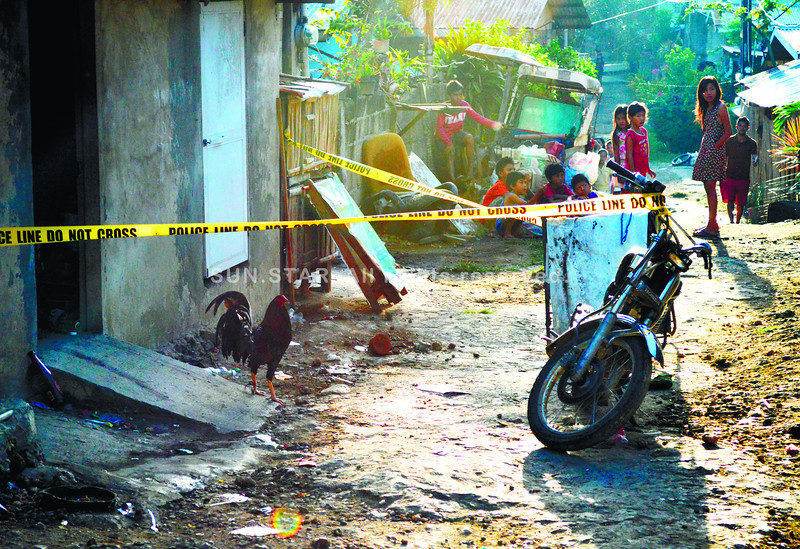 The house of Francisco Ariva in Pulpogan, Consolacion, Cebu (abo, is cordoned off after a raid and a shootout with police leads to four men being killed. (Photo by Alan Tangcawan of Sun.Star Cebu)