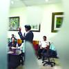 Mayor Mike Rama sings during meeting with envoys