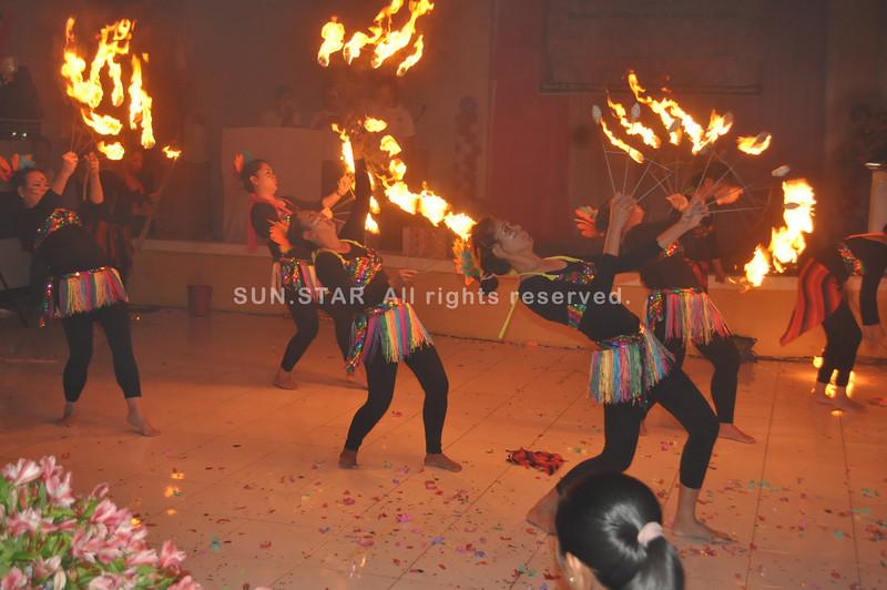 Bataan policewomen performing a fire dance