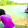 Children ride bamboo raft to school