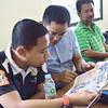 PICS AND A STORY. CFA Disciplinary Committee members Atty. Julius Ceasar S. Entise (left) and Nimrod Quiñones review a photo of the incident that came out in Sun.Star Superbalita. The CFA has handed out six-month ban to the coaches and players and is expected to mete out further sanctions to the spectators who got involved, including the guy in green whose identity has been given to the CFA by the Alcoy coach. (SUN.STAR FOTOS AMPER CAMPAÑA, ALLAN CUIZON)