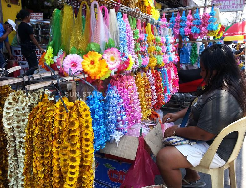 Garland vendor at Cogon Market, Cagayan de Oro City