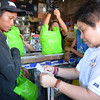 Bureau of Internal Revenue Commissioner Kim Henares checks a receipt that a store near the Lapu-Lapu City Market