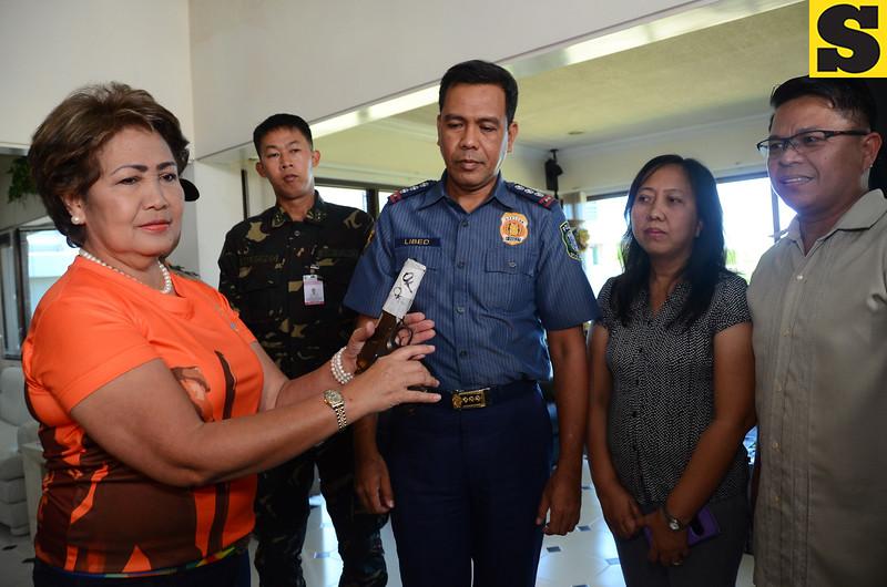 Lapu-Lapu City Mayor Paz Radaza surrenders gun