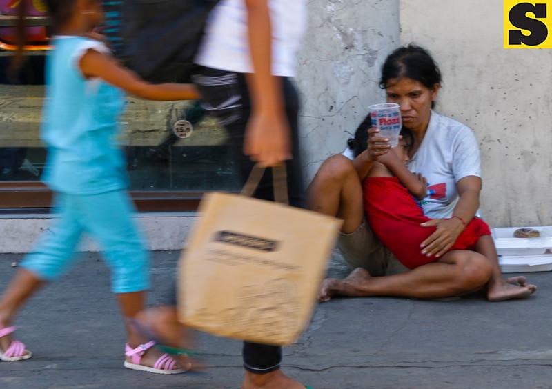 Beggars on sidewalk