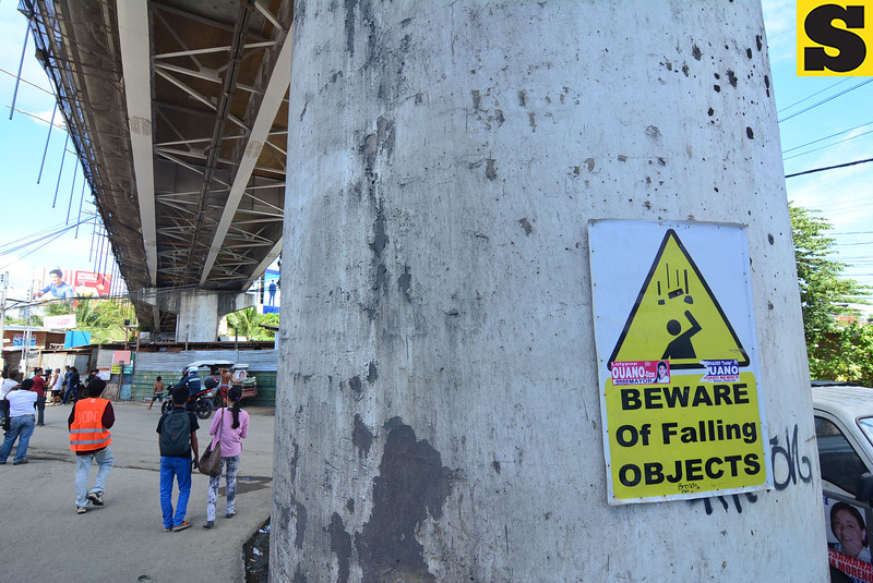 Beware of falling objects sign posted under the Mandaue-Mactan bridge
