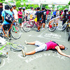 "WHY THE CITY NEEDS BIKE LANES. As a pre-Earth Hour activity, environment advocates and bicycle groups air their demands for road rights, staging a symbolic ""vehicular accident"" to stress the need for bicycle lanes in Cebu City's thoroughfares. The groups gathered on their bikes along Osmeña Blvd. yesterday. (Arni Aclao)"