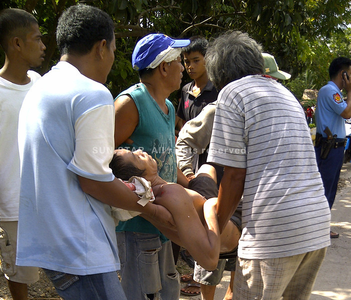 ZAMBOANGA. People working on a rip-rap project carry their co-worker who was injured when the river wall collapses in the village of Cabaluay. (Bong Garcia)