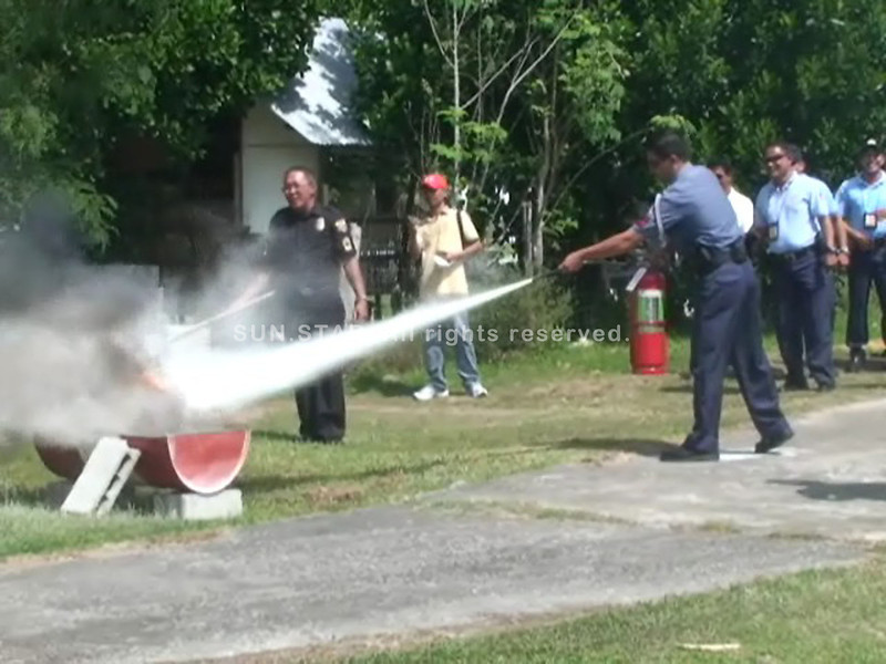 DUMAGUETE. Policemen belonging to the Aviation Security Group assigned at the Dumaguete Airport set off a fire in a fire fighting demonstration Wednesday. (Victor L. Camion)