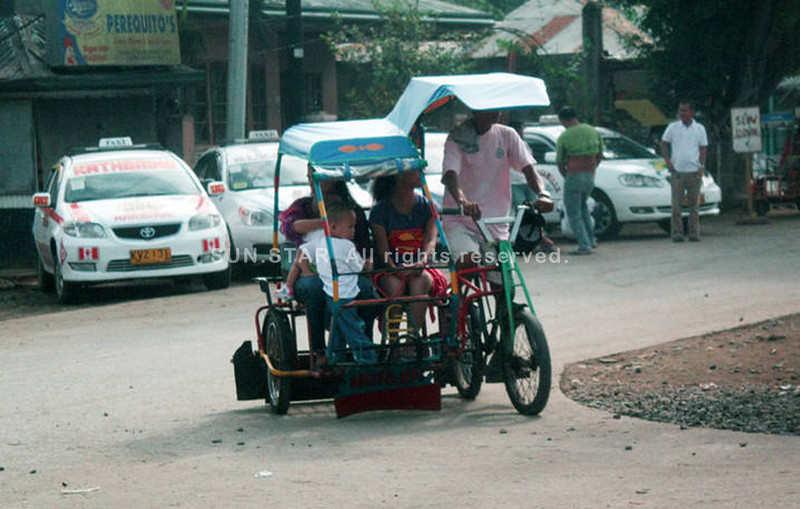 CAGAYAN DE ORO. Some commuters prefer to ride in 'trisikads', which charge only P5 per person, while fares in public utility jeepneys are now pegged at P8. (Joey P. Nacalaban)