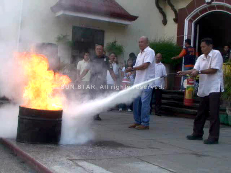 DUMAGUETE. Some employees of the local government of Dumaguete join a fire fighting demonstration held at the City's stage Thursday morning. (Victor L. Camion)