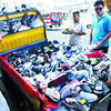 SHOES ON WHEELS.These pairs of shoes can go anywhere. The vendor, who came up with the idea of converting the back of a multicab into a mobile shoe store, would have to watch out for traffic enforcers in case he decides to stop in a no-parking zone.(Arni Aclao)