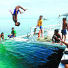 FLIPPING OUT AT SEA.Children of Caubian Island in Lapu-Lapu City have fun aboard a motor boat while its passengers take a tour of the island. (Arni Aclao)