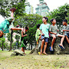 URBAN PLAYGROUND.  Children spend their Sunday afternoon within Fuente Osmeña circle, with a large stump for a bench and a sparse carpet of grass for an acrobatics stage. They're still too young for the summer job program at City Hall. Story below.  (Amper Campana)