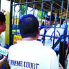 CEBU. Court Sheriff Manuel Gimeno (center, back to camera) and process server Rey Christian Matta are kept out of the St. Theresa's College in Cebu City. (Arni Aclao)