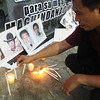 CAGAYAN DE ORO. Michael Angelo Bustamante, a member of the Cagayan de Oro Press Club (COPC), lights a candle remembering the slain journalists in the gruesome Maguindanao massacre on Thursday. (Joey P. Nacalaban)