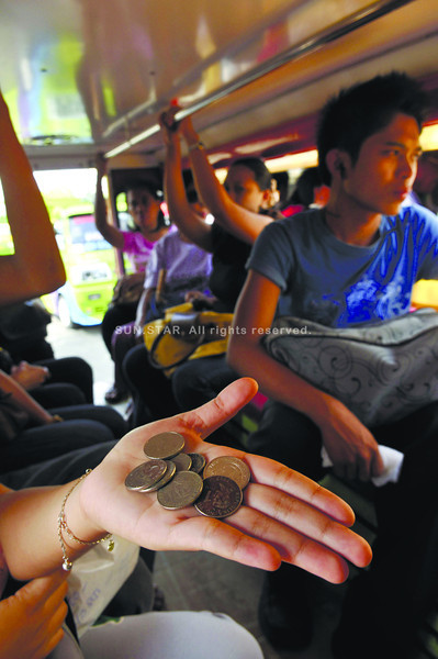 PROVISIONAL FARE HIKE.The Land Transportation Franchising and Regulatory Board 7 has allowed public utility jeepney drivers to collect P8 as minimum fare for the first five kilometers.(Alex Badayos)