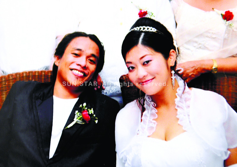 Picture of couple Dexter Louie Denila and his Japanese wife Kotoka Kajii during their wedding last year. Taken from the family album brought to the police station. (Allan Cuizon)
