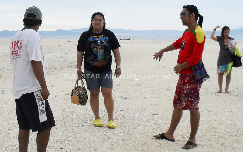 ZAMBOANGA. Dapitan City Councilor Apple Marie Agolong is seen in this file photo accompanying a small group of visitors at the pristine and white beach of Aliguay Island. (Bong Garcia)