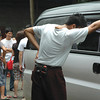DAVAO. Grief is written in the body language of a man, apparently a relative, as he rests his hand on the hearse that carries the body of grocery store owner Henry Ong, 54. Ong was found stabbed and beaten to death at the third floor of the Universal Grocers Corporation Building along Saavedra Street in Toril, Monday morning. (King Rodriguez)