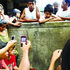 CEBU.People who claim to see a face on this concrete wall gather at the Danao Public Market to light candles, pray and snap photos. (Allan Cuizon)