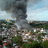 CEBU. Thick, black smoke filled the sky above houses made of light materials that caught fire Friday in sitio Cabantan, Barangay Luz, Cebu City. (Photo by Gerome Dalipe of Sun.Star Cebu)