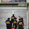 CAGAYAN DE ORO. Scene of the Crime Operatives (Soco) are doing their investigation and ocular inspection on the establishment owned by businessman Rommel A. Cutar a few minutes after two unidentified suspects strafed the store. (Joey P. Nacalaban)