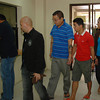 DAVAO. Suspected illegal recruiters walk with a National Bureau of Investigation (NBI) agent to the City Prosecutor's Office for inquest on large scale and syndicated illegal recruitment charges. (King Rodriguez)