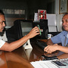 """CAGAYAN DE ORO. James Licuanan aka """"Bombo James Dacoycoy"""" (left) shows to his station manager, Celso Maldecir (right), the alleged death threat sent through his mobile phone. (Joey P. Nacalaban)"""