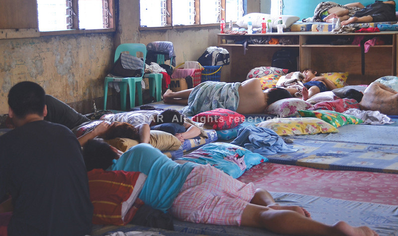 DAVAO. The Taiwanese nationals, whose case filed against them by the Davao City Police has been dismissed by the court in Davao City, rest in a room inside the Davao City Police Office for lack of a detention cell big enough for all of them. (Seth Delos Reyes)