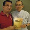 "PAMPANGA. San Fernando Archbishop Paciano Aniceto endorses the book ""Iniang Malati Ku"" by Irwin Nucum (left) for use in Kapampangan language instruction at elementary schools. (Ian Ocampo Flora)"
