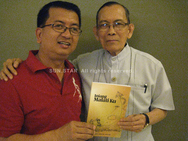 "PAMPANGA. San Fernando Archbishop Paciano Aniceto endorses the book ""Iniang Malati Ku"" by Irwin Nucum (left) for use in Kapampangan language instruction at elementary schools. (Ian Ocampo Flora)"