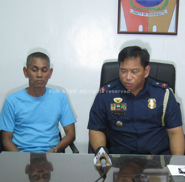 ZAMBOANGA. Newly-freed policeman Faisal Juhaili (left) listens intensely while Chief Supt. Napoleon Estilles, police regional director, answers question in a presscon Wednesday afternoon. PO2 Juhaili is one of the four policemen on duty when some 40 NPAs raided the police station of Tigbao town last April 9. (Bong Garcia)