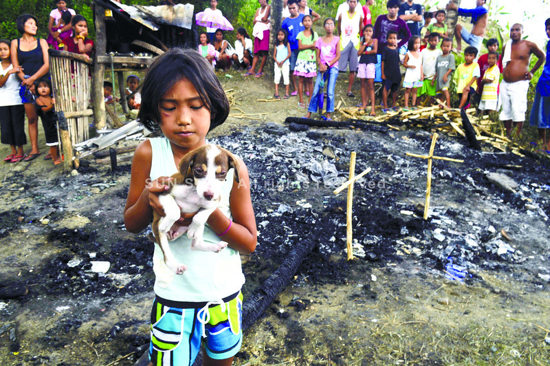 CEBU. Two brothers died in a fire that hit their home in Barangay Sam-ang, Toledo City, Cebu last Friday night. Their pet puppy, Britney survived. (Alex Badayos)
