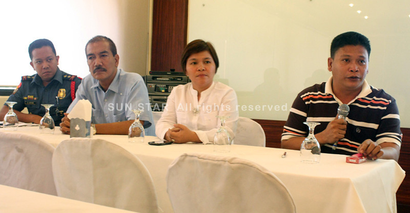 CAGAYAN DE ORO. Opol town Mayor Dexter Yasay (extreme right) explains the legitimacy of Nakeen Corporation's operations in his town during a press conference Wednesday. (Joey P. Nacalaban)