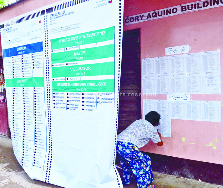 Voter checks her precinct