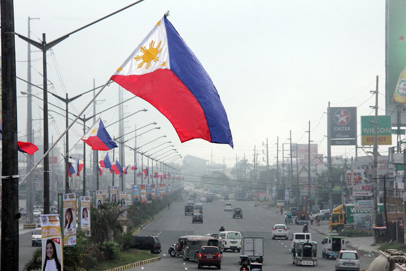 PAMPANGA. Dozens of Philippine Flags are placed along the Jose Abad Santos Avenue in the City of San Fernando in commemoration of National Flag Day today, May 28. (Chris Navarro)