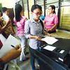 CEBU.  Journalist Flor Gitgano of Sun.Star Cebu casts a sample ballot in the Abellana National School on the final day of testing and sealing of the ballot-scanning machines.  (Alex Badayos)