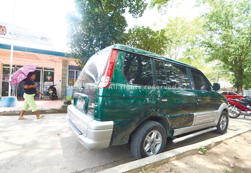 'GETAWAY' VEHICLE. Law enforcers found the green Mitsubishi Adventure with government license plates allegedly used by Joavan Fernandez, who escaped from his detention cell at a Talisay City Police station, in Mandaue City. The vehicle is in the costudy of the Talisay Police. (Alex Badayos)