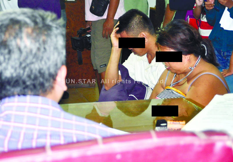 Couple arrested in Cordova, Cebu for cybersex