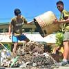 DAVAO. Mga sakop sa Philippine Air Force misuporta sa Brigada Eskwela sa F. Bangoy Elementary School kagahapon sa buntag. Ilang adopted school ang maong tunghaan sa dakbayan sa Davao. (Seth Delos Reyes)