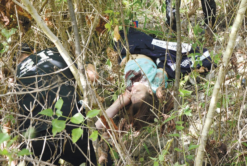 The woman, who bore a gunshot in her chest was first reported as unidentified but was later revealed to be Johamma Luage, a widow of a policeman. Her ID cards were found inside Oybenes' vehicle. (Alex Badayos)