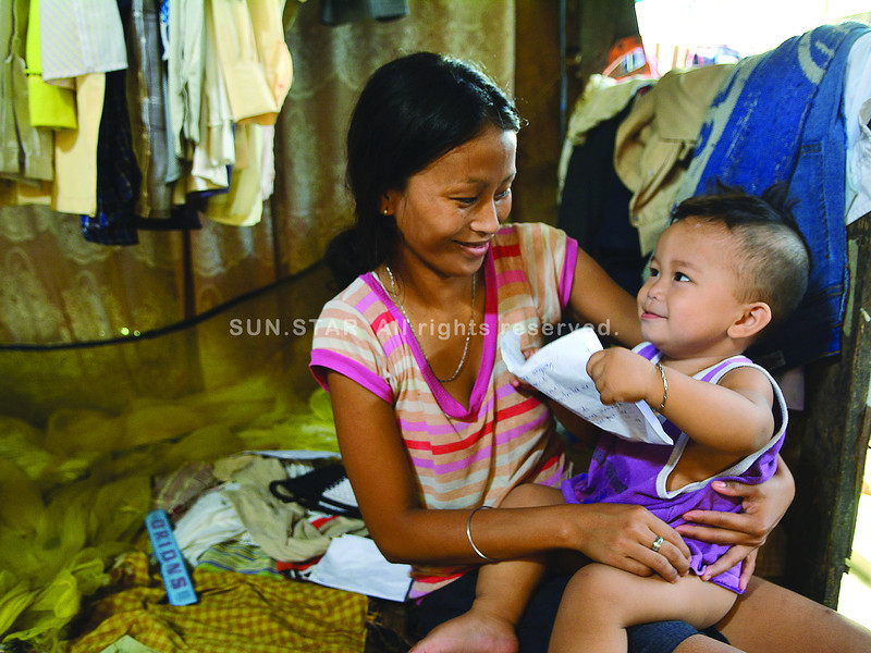 Deaf-mute mother JeAnn Retubado Garzo, 21 despite her impairment try to communicate with her son John Matthew Garzo. Her husband is also a deaf mute.<br /> <br /> photo Allan Cuizon