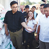 NOT SWEET. X-Ray Inspection Project head Lourdes Mangaoang (center), with Customs Commissioner Ruffy Biazon (left) and Cebu Customs District Collector Ronnie Silvestre (right), led the opening of the 10 20-footer container vans of illegally imported sugar from Thailand worth over P7 million Thursday afternoon (November 29, 2012). (Sun.Star Photo/Amper Campana)