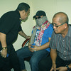 CAGAYAN DE ORO. Lawyer Alex Caburnay (far left), chief of the National Bureau of Investigation (NBI) Iligan City District, talks to Jachob Rasuman (center) inside the NBI regional office in Cagayan de Oro where he was brought. With Rasuman is his legal counsel, lawyer Michael Florentino Dumlao (right). (Joey P. Nacalaban)