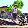 UP AND STILL SMILING. A boy walks among the ruins of his family's house after a demolition ordered in the North Reclamation Area by the Cebu City Government, which owns the land. (Amper Campaña)